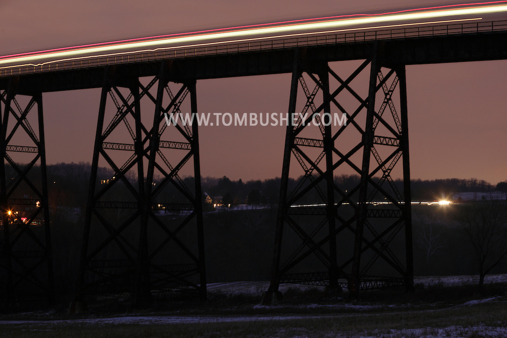 Salisbury Mills, NY - Lights from a passing train forms streaks  Moodna Viaduct railroad trestle at dusk during a 20-second exposure on Jan. 1, 2010.