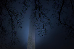 The Washington Monument is blocked by a rain cloud in Washington, DC on December 2, 2018.