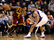 Nov. 09, 2012; Phoenix, AZ, USA; Cleveland Cavaliers guard Kyrie Irving (2) handles the ball against the Phoenix Suns forward Jared Dudley (3) during the second half at US Airways Center. The Suns defeated the Cavaliers 107-105. Mandatory Credit: Jennifer Stewart-US PRESSWIRE.
