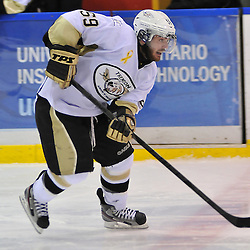 WHITBY, ON - Oct 7: Ontario Junior Hockey League game between Trenton Golden Hawks and Whitby Fury. Nick Marinac of the Trenton Golden Hawks Hockey Club skates with the puck during third period game action..(Photo by Shawn Muir / OJHL Images)