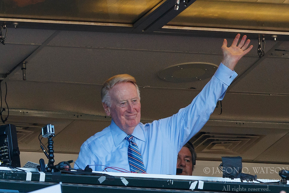 SAN FRANCISCO, CA - OCTOBER 02: Broadcaster Vin Scully waves to the crowd during the seventh inning between the San Francisco Giants and the Los Angeles Dodgers at AT&T Park on October 2, 2016 in San Francisco, California. The San Francisco Giants defeated the Los Angeles Dodgers 7-1. (Photo by Jason O. Watson/Getty Images) *** Local Caption *** Vin Scully