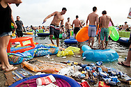 Empty cans and bottles litter the shoreline during Floatopia event in Mission Bay near Fanuel Street Park in San Diego, March 20, 2010. Roughly 5,000 people took to the water to skirt an alcohol ban on San Diego's beaches.