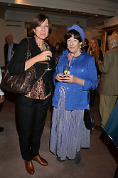 Left to right, RUTH GUILDING and MIN HOGG at a reception to celebrate the publication of Hockney - A Pilgrim's Progress by Christopher Simon Sykes held at Sotheby's, New Bond Street, London on 30th September 2014.