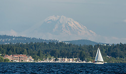 United States, Washington, Kirkland, sailboat on Lake Washington with Mt. Rainier in distance