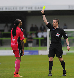 Dover Athletic's Ricky Modeste receives a yellow card from the referee - Photo mandatory by-line: Nizaam Jones - Mobile: 07966 386802 - 25/04/2015 - SPORT - Football - Nailsworth - The New Lawn - Forest Green Rovers v Dover - Vanarama Conference League