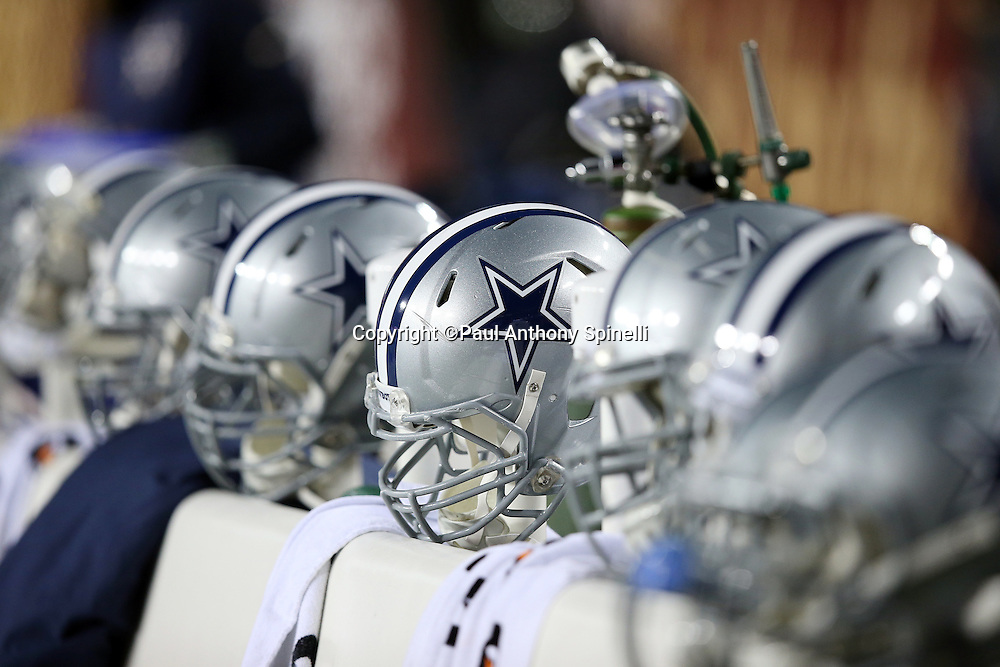 A row of Dallas Cowboys helmets is lined up on the sideline bench before the Dallas Cowboys 2015 week 13 regular season NFL football game against the Washington Redskins on Monday, Dec. 7, 2015 in Landover, Md. The Cowboys won the game 19-16. (©Paul Anthony Spinelli)