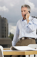 Business man using phone in office
