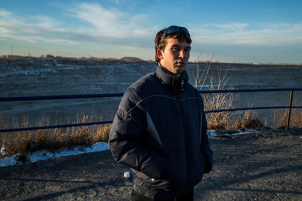 Nikolai Ross stands at an overlook at the Uralasbest asbestos mine on Sunday, November 24, 2013 in Asbest, Russia.