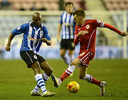 Wigan Athletic's Emmerson Boyce is challenged by Cardiff City's Craig Noone - Photo mandatory by-line: Richard Martin-Roberts/JMP - Mobile: 07966 386802 - 24/02/2015 - SPORT - Football - Wigan - DW Stadium - Wigan Athletic v Cardiff City - Sky Bet Championship