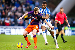 Kevin De Bruyne of Manchester City takes on Steve Mounie of Huddersfield Town - Mandatory by-line: Robbie Stephenson/JMP - 20/01/2019 - FOOTBALL - The John Smith's Stadium - Huddersfield, England - Huddersfield Town v Manchester City - Premier League
