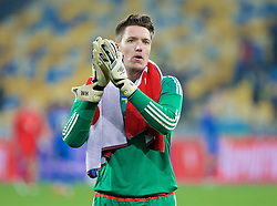 KIEV, UKRAINE - Easter Monday, March 28, 2016: Wales' goalkeeper Wayne Hennessey applauds the travelling supporters after the 1-0 defeat to Ukraine during the International Friendly match at the NSK Olimpiyskyi Stadium. (Pic by David Rawcliffe/Propaganda)
