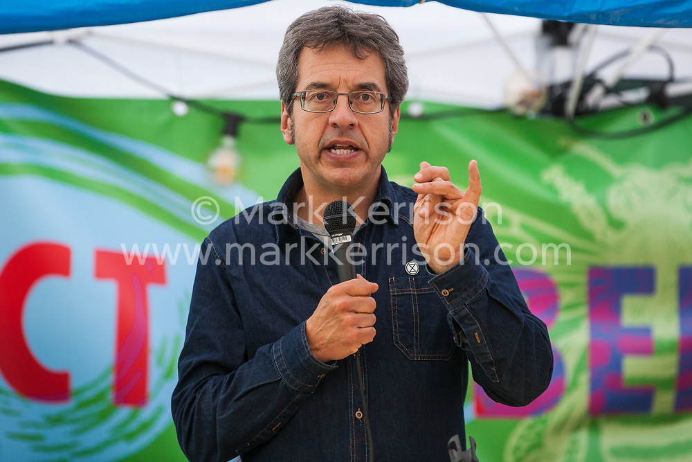 London, UK. 9 October, 2019. George Monbiot addresses climate activists from Extinction Rebellion blockading Trafalgar Square on the third day of International Rebellion protests to demand a government declaration of a climate and ecological emergency, a commitment to halting biodiversity loss and net zero carbon emissions by 2025 and for the government to create and be led by the decisions of a Citizens' Assembly on climate and ecological justice.