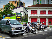 11 DECEMBER 2018 - SINGAPORE:  Traffic at an intersection in the Geylang neighborhood. The Geylang area of Singapore, between the Central Business District and Changi Airport, was originally coconut plantations and Malay villages. During Singapore's boom the coconut plantations and other farms were pushed out and now the area is a working class community of Malay, Indian and Chinese people. In the 2000s, developers started gentrifying Geylang and new housing estate developments were built.      PHOTO BY JACK KURTZ