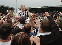 Photo: Leigh Quinnell.<br /> Notts County v Bury. Coca Cola League 2. 06/05/2006.<br /> Fans hoist Notts Countys David Pipe in the air to celebrate staying in the football league.