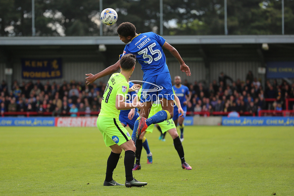 AFC Wimbledon defender Tony Sibbick (35) winning header during the EFL Sky Bet League 1 match between AFC Wimbledon and Peterborough United at the Cherry Red Records Stadium, Kingston, England on 17 April 2017. Photo by Matthew Redman.
