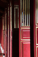A series of doors in the Imperial Citadelin Hue, Vietnam, Photograph by Dennis Brack