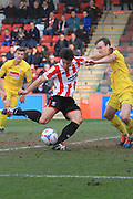 Dan Holman scores and celebrates his 2nd goal from a Jack Munns corner during the Vanarama National League match between Cheltenham Town and Woking at Whaddon Road, Cheltenham, England on 12 March 2016. Photo by Antony Thompson.