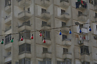 Lightbulbs strung out on a street in Cairo.