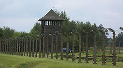 A guard tower and barbed wire fences at the Auschwitz-Birkenau Nazi concentration camps in Auschwitz, Poland on September 3, 2017. Auschwitz concentration camp was a network of German Nazi concentration camps and extermination camps built and operated by the Third Reich in Polish areas annexed by Nazi Germany during WWII. It consisted of Auschwitz I (the original camp), Auschwitz II–Birkenau (a combination concentration/extermination camp), Auschwitz II–Monowitz (a labor camp to staff an IG Farben factory), and 45 satellite camps. In September 1941, Auschwitz II–Birkenau went on to become a major site of the Nazi Final Solution to the Jewish Question. From early 1942 until late 1944, transport trains delivered Jews to the camp's gas chambers from all over German-occupied Europe, where they were killed en masse with the pesticide Zyklon B. An estimated 1.3 million people were sent to the camp, of whom at least 1.1 million died. Around 90 percent of those killed were Jewish; approximately 1 in 6 Jews killed in the Holocaust died at the camp. Others deported to Auschwitz included 150,000 Poles, 23,000 Romani and Sinti, 15,000 Soviet prisoners of war, 400 Jehovah's Witnesses, and tens of thousands of others of diverse nationalities, including an unknown number of homosexuals. Many of those not killed in the gas chambers died of starvation, forced labor, infectious diseases, individual executions, and medical experiments. In 1947, Poland founded a museum on the site of Auschwitz I and II, and in 1979, it was named a UNESCO World Heritage Site. Photo by Somer/ABACAPRESS.COM