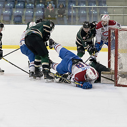 KINGSTON, ON - MAR 9,  2017: Ontario Junior Hockey League, playoff game between the Cobourg Cougars and Kingston Voyageurs, Rob Clerc #18 of the Kingston Voyageurs collides with goaltender during the 1st period.<br /> (Photo by Ian Dixon/ OJHL Images)