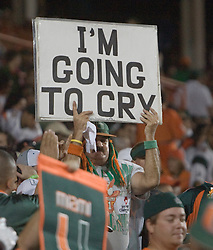 """A Miami fan holds up a sign saying """"I'm Going To Cry"""" during the final Miami Hurricanes football game in the 70 year old Orange Bowl.  The #19 Virginia Cavaliers defeated the Miami Hurricanes 48-0 at the Orange Bowl in Miami, Florida on November 10, 2007.  The game was the final game played in the Orange Bowl and the worst shutout defeat for Miami in stadium history."""