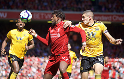LIVERPOOL, ENGLAND - Sunday, May 12, 2019: Liverpool's Divock Origi (L) and Wolverhampton Wanderers' captain Conor Coady during the final FA Premier League match of the season between Liverpool FC and Wolverhampton Wanderers FC at Anfield. (Pic by David Rawcliffe/Propaganda)