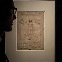 Foto Piero Cruciatti / LaPresse<br /> 14-04-2015 Milano, Italia<br /> Cultura<br /> Anteprima stampa della mostra &quot;Leonardo da Vinci 1452 - 1519&rdquo; a Palazzo Reale<br /> Nella Foto: un visitatore guarda 'Uomo Vitruviano'<br /> <br /> Photo Piero Cruciatti / LaPresse<br /> 14-04-2015 Milan, Italy<br /> Cultura<br /> Press preivew of the exhibition &quot;Leonardo da Vinci 1452 - 1519&rdquo; at Palazzo Reale <br /> In the Photo: a visitor looks up at 'Uomo Vitruviano'