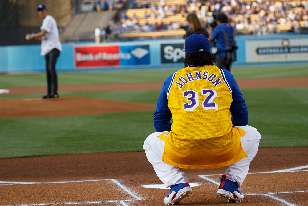 Dodgers pitcher Kenley Jansen wears a Lakers jersey as Lakers draft pick Lonzo Ball throws out the first pitch at Dodger Stadium on Friday, June 23, 2017 in El Segundo, California. The Lakers selected Lonzo Ball as the No. 2 overall NBA draft pick and is the son of LaVar Ball. © 2017 Patrick T. Fallon