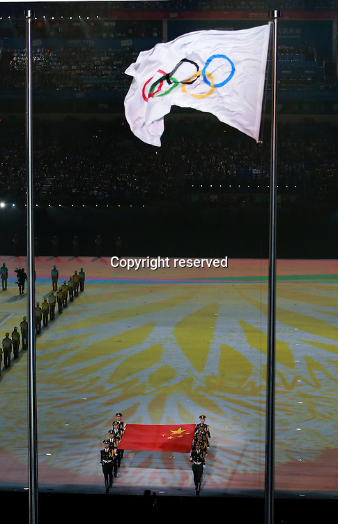 28.08,2014. Nanjing, China.  The national flag of People?s Republic of China enters the stadium during the closing ceremony of Nanjing 2014 Youth Olympic Games in Nanjing, capital of east Chinas Jiangsu Province, Aug. 28, 2014.