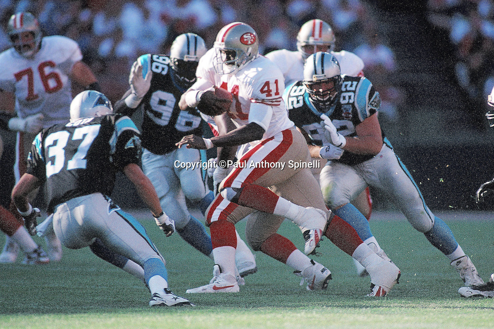 An unidentified San Francisco 49ers running back (41) runs the ball while being chased by Carolina Panthers defensive end Shawn Price (92) during the NFL preseason football game against the Carolina Panthers on Aug. 19, 1995 in San Francisco. The 49ers won the game 17-10. (©Paul Anthony Spinelli)