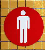 men restroom signal on the yellow ceramic background