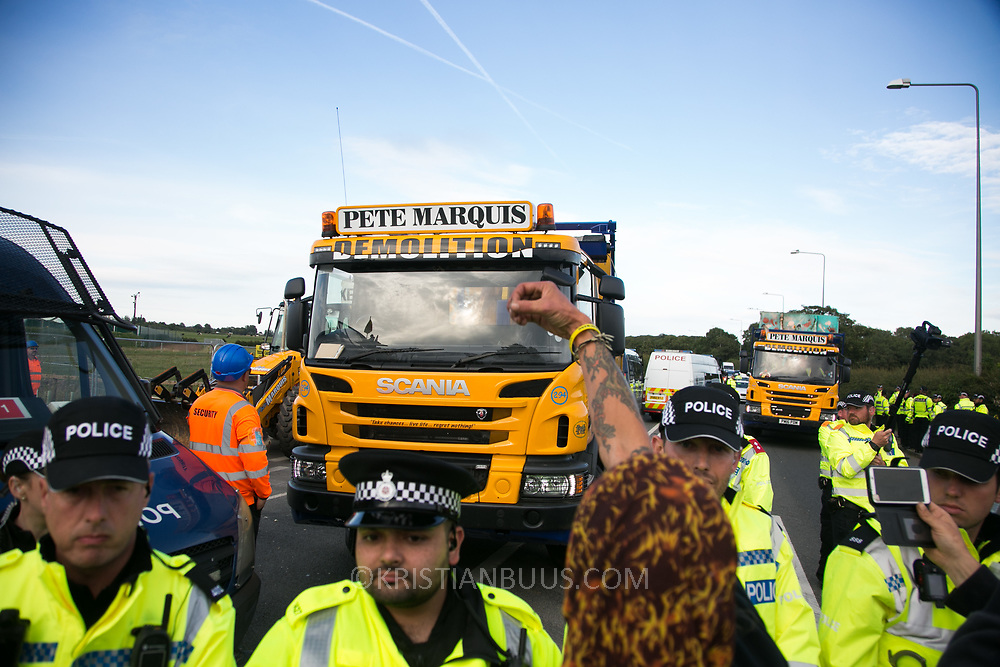 13 local activists locked themselves in specially made arm tubes to block the entrance to Quadrilla's drill site in New Preston Road, July 03 2017, Lancashire, United Kingdom. Pete Marquis and his men demolish a tower erected by activists. Pete Marquis, a pro-fracker and highly controversial local entrepeneur who owns a hauling company.The 13 activists included 3 councillors; Julie Brickles, Miranda Cox and Gina Dowding and Nick Danby, Martin Porter, Jeanette Porter,  Michelle Martin, Louise Robinson,<br /> Alana McCullough, Nick Sheldrick, Cath Robinson, Barbara Cookson, Dan Huxley-Blyth. The blockade is a repsonse to the emmidiate drilling for shale gas, fracking, by the fracking company Quadrilla. Lancashire voted against permitting fracking but was over ruled by the conservative central Government. All the activists have been active in the struggle against fracking for years but this is their first direct action of peacefull protesting. Fracking is a highly contested way of extracting gas, it is risky to extract and damaging to the environment and is banned in parts of Europe . Lancashire has in the past experienced earth quakes blamed on fracking.
