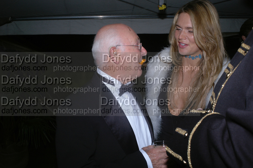 MURRAY WALKER AND CELIA WALDEN, Goodwood Revival Ball. Saturday 17 September 2005.  ONE TIME USE ONLY - DO NOT ARCHIVE  © Copyright Photograph by Dafydd Jones 66 Stockwell Park Rd. London SW9 0DA Tel 020 7733 0108 www.dafjones.com