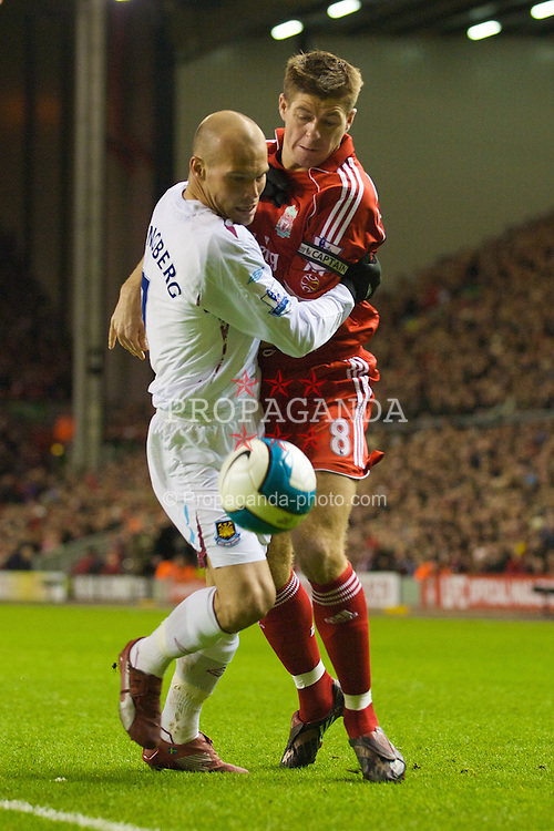 LIVERPOOL, ENGLAND - Wednesday, March 5, 2008: Liverpool's captain Steven Gerrard MBE and West Ham United's Fredrik Ljungberg during the Premiership match at Anfield. (Photo by David Rawcliffe/Propaganda)