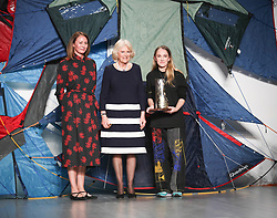 February 19, 2019 - London, United Kingdom - HRH Duchess of Cornwall Camilla presents Elizabeth II Award for young talents in fashion to the winner Bethany Williams (from left Caroline Rush, HRH Duchess of Cornwall, Bethany Williams) during London Fashion Week February 2019 at the BFC show space on February 19, 2019 in London, England. (Credit Image: © Dominika Zarzycka/NurPhoto via ZUMA Press)