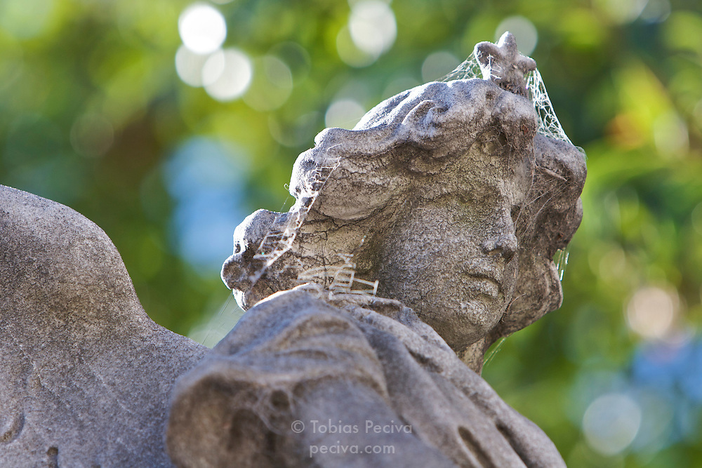 Detail of an angel statue on a tomb in the Recoleta necropolis (Cementerio de la Recoleta), Buenos Aires.