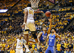 Jan 27, 2018; Morgantown, WV, USA; West Virginia Mountaineers forward Sagaba Konate (50) blocks a shot in the lane by Kentucky Wildcats forward PJ Washington (25) during the first half at WVU Coliseum. Mandatory Credit: Ben Queen-USA TODAY Sports