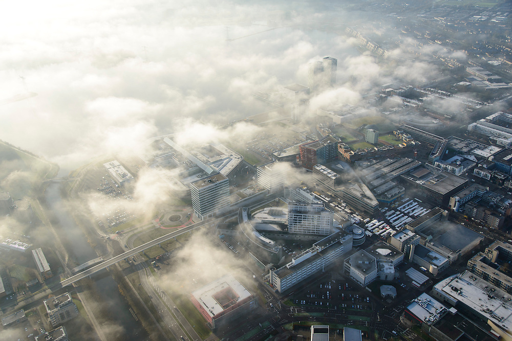 Nederland, Flevoland, Almere, 11-12-2013; Stadshart van Almere in de mist, de hoogbouw aan het Weerwater steekt net boven de wolken uit.<br /> Heart of the newly constructed city of Almere in the fog.<br /> luchtfoto (toeslag op standaard tarieven);<br /> aerial photo (additional fee required);<br /> copyright foto/photo Siebe Swart.