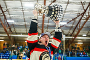 Derek Klassen raises the Coy Cup after the Huskies defeated the Kelowna Sparta 7-4 in the championship game. Klassen was named first star of the game with two goals.