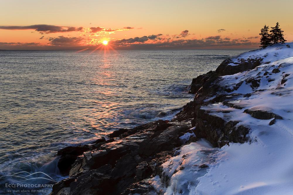 Sunrise over the Atlantic Ocean in winter as seen from near Schooner Head on Maine's Acadia National Park.