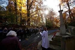 © Licensed to London News Pictures. 11/11/2012. Whitchurch-on-Thames, Reading, Berkshire. Local people of the Parishes of Whitchurch-on-Thames and Goring Heath gather at the War Memorial on Whitchurch Hill to remember the fallen on Remembrance Sunday, at a Memorial Service. Rev Claire Alcock took the service in amongst the autumnal beech trees at the memorial purposely built between the two parishes. Photo credit : Rebecca Mckevitt/LNP