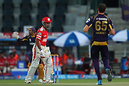 Wriddhiman Saha of the Kings X1 Punjab looks back at Morne Morkel of the Kolkata Knight Riders after two high balls during match 15 of the Pepsi Indian Premier League 2014 Season between The Kings XI Punjab and the Kolkata Knight Riders held at the Sheikh Zayed Stadium, Abu Dhabi, United Arab Emirates on the 26th April 2014<br /> <br /> Photo by Ron Gaunt / IPL / SPORTZPICS