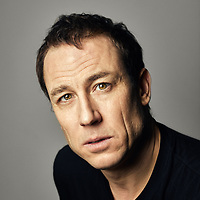 """Tobias Menzies is a stage, television and film actor. He is best known for his role as Brutus in HBO's Rome, Edmure Tully in HBO's Game of Thrones, and the dual roles of Frank and Jonathan """"Black Jack"""" Randall in STARZ's Outlander, which earned him a Golden Globe Award nomination.<br /> So much of the portraiture commissioned in the press and print industry is reluctant to take risks. I want to challenge that safety and introduce moments of spontaneity and awkwardness. Too often portraits of people, famous or even notorious, are aggrandising and sycophantic. I want to strip back the artifice and enforce strangeness and quietness in its place.<br /> Working at the London Studio with Tobias gave me the chance to experiment with a series of interesting expressions and characters. The session lasting just over an hour, I was able to capture a portfolio of truly spontaneous and unique portraits."""