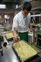 Restaurant Bras, Laguiole, in the Aubrac region, France..Preparation and eating of the staff meal -  the potatoes