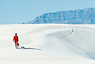 Woman walking in White Sands National Monument, MODEL RELEASED, PROPERTY RELEASED
