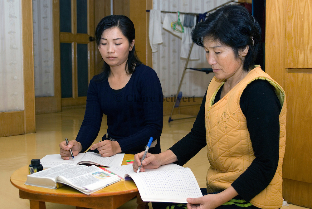 A young North Korean woman and her mother studying the Bible in their appartment in Yangi. They escaped North Korea to find a job and to get money for their family. The Chinese goverment is chasing North Koreans offering 500 dollars for information. Most of the defectors are women. They are often forced to work as prostitutes and forced to marry a Chinese. She just wants to earn enough money to pay for her illegal travel to South Korea : 2500 dollars. Up to 300, 000 North Korean illegals are belived to be hiding in Yanbian province. Around 8000 succeeded to reach South Korea.