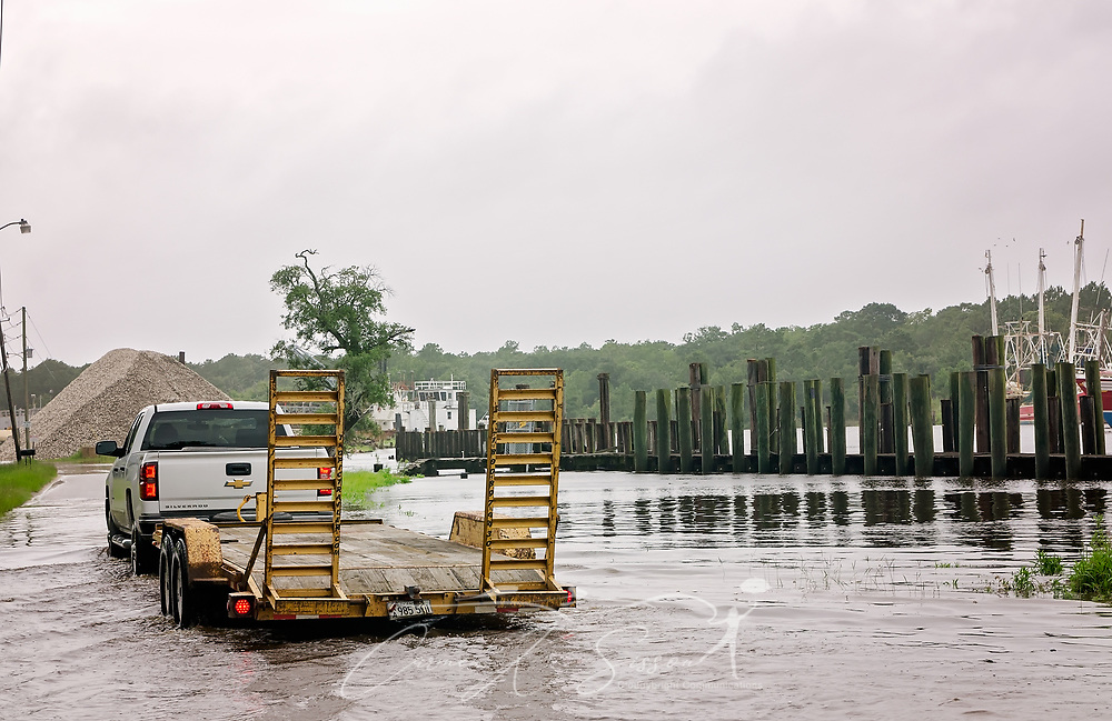 A truck makes its way down Shell Belt Road, June 22, 2017, in Bayou La Batre, Ala. The bayou experienced significant flooding along Shell Belt Road following heavy rains caused by Tropical Storm Cindy. The tropical storm made landfall at daybreak near Lake Charles, La., leaving one person dead and a drenched Gulf Coast, from Texas to Florida, in its wake. (Photo by Carmen K. Sisson/Cloudybright)