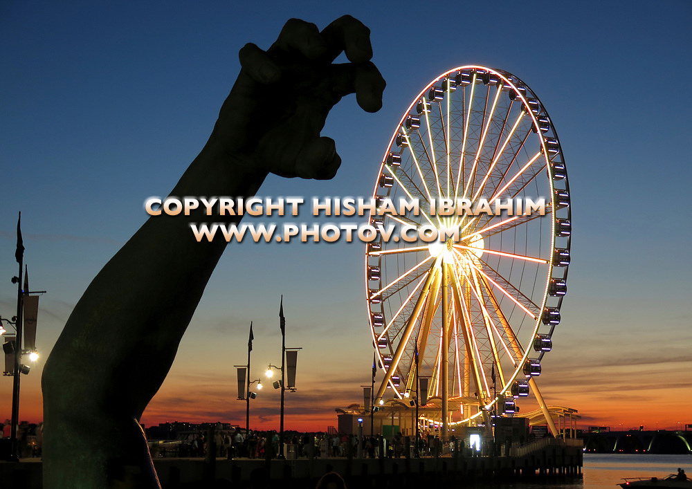 National Harbor and The Capital Wheel illuminated at Dusk, Maryland, USA.