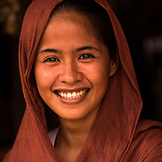 """Shop keeper with a fantastic smile.<br /> <br /> The SARANGANS showcase enormous cultural diversity of Blaan, Tboli, Tagakaolo, Kalagan, Manobo, Ubo, Muslim tribes and Christian settlers. Hospitable and fun-loving """"Sarangans"""" (people of Sarangani) adhere to a unified direction for development.<br /> Muslim consists of 7 groups; the Lumads, 17; and the migrant settlers, at least 20. The Blaans characterize the largest minority and are distributed in the municipalities of Malapatan, Glan, Alabel, Maasim, and Malungon. A bulk of this tribe is found in Malapatan constituting 37% of the municipal household population.<br /> The Maguindanaos are settled in the municipalities of Malapatan, Maitum, and Maasim; Tbolis reside mostly in Maitum, Kiamba, and Maasim while Tagakaolos subsist entirely in Malungon.<br /> Cebuano settlers are found in Glan and Alabel; Ilonggos are situated in Malungon while the Ilocanos live mostly in Kiamba and Maitum.<br /> Thus, Sarangani's mixed population of Cebuano-speaking Blaans and Muslims in the east coast, Ilocano-speaking Tbolis, Manobos and Muslims in the west coast, and Ilonggo-speaking Blaans and Kaolos in the north uplands, is unique and in harmony."""