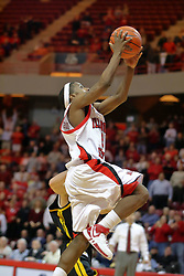 "18 January 2007: Keith ""Boo"" Richardson makes a lay up after steeling the ball and beating the Shockers to the other end.  This basket sealed the victory for the Redbirds. The Shockers of Wichita State were shut off by the Redbirds by a score of 83-75 at Redbird Arena in Normal Illinois on the campus of Illinois State University."